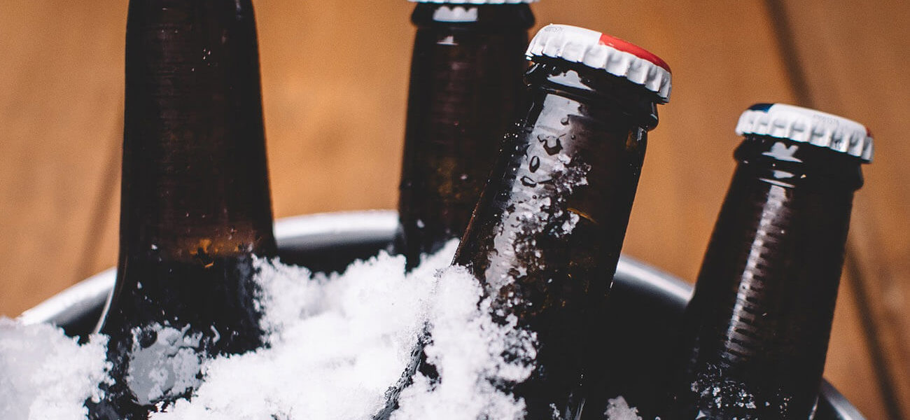 beer-chronicle-houston-craft-beer-review-what-is-skunked-beer-brown-bottles-on-ice