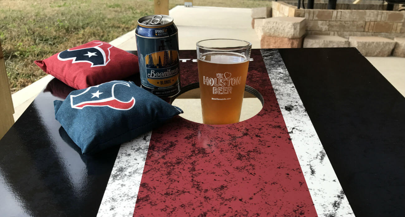 Beer-Chronicle-Houston-Craft-Beer-Review-Boomtown-Blonde-on-cornhole-board