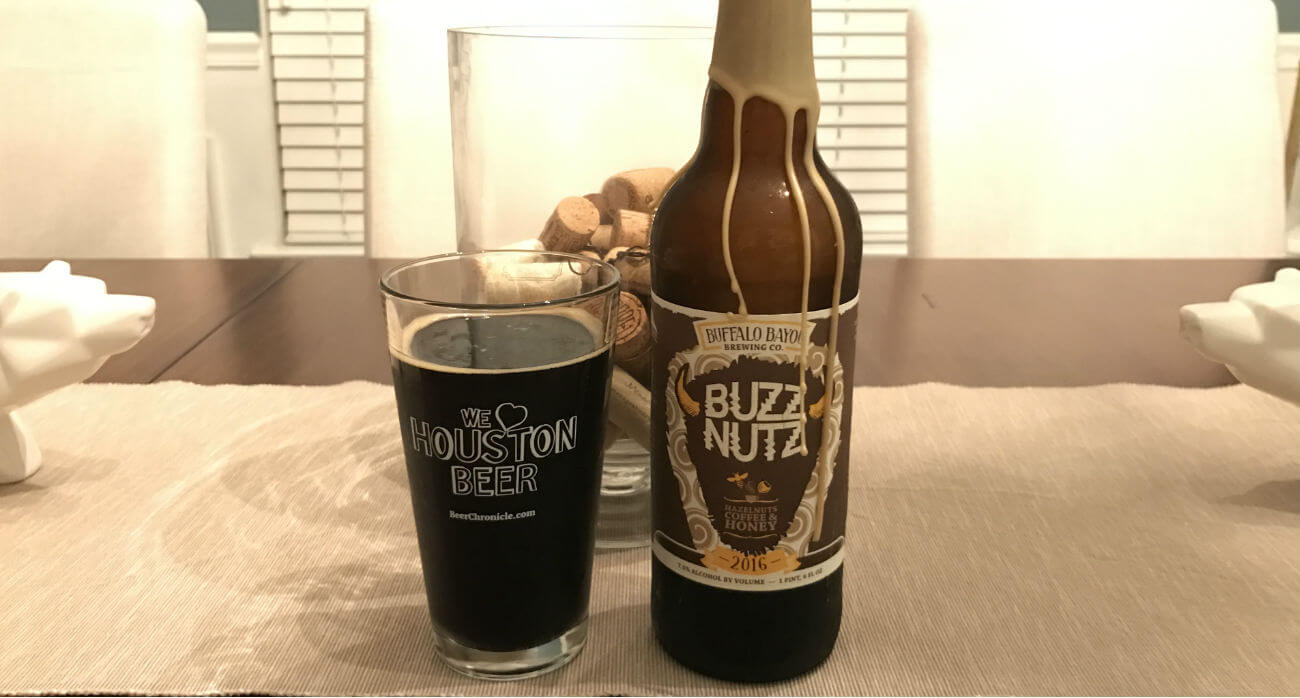 beer-chronicle-houston-craft-beer-review-buzz-nutz-beer-with-bottle-on-wooden-table