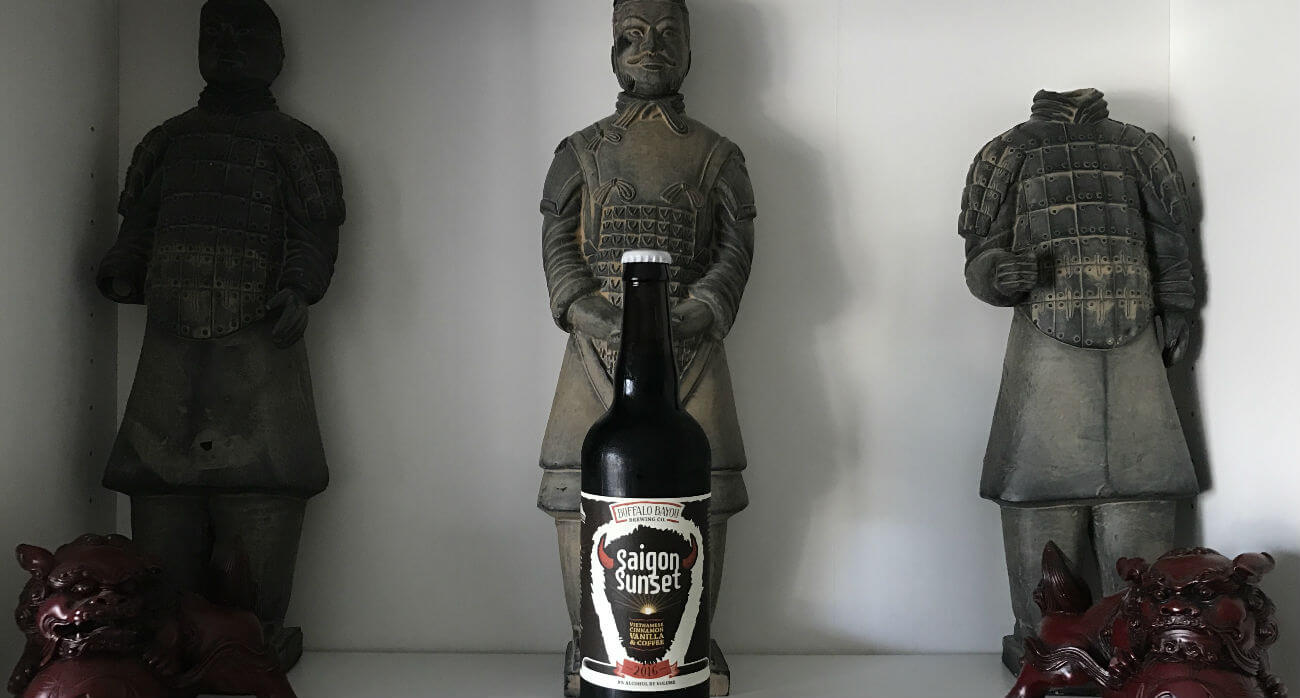 beer-chronicle-houston-craft-beer-review-saigon-sunset-beer-placed-in-front-of-statues