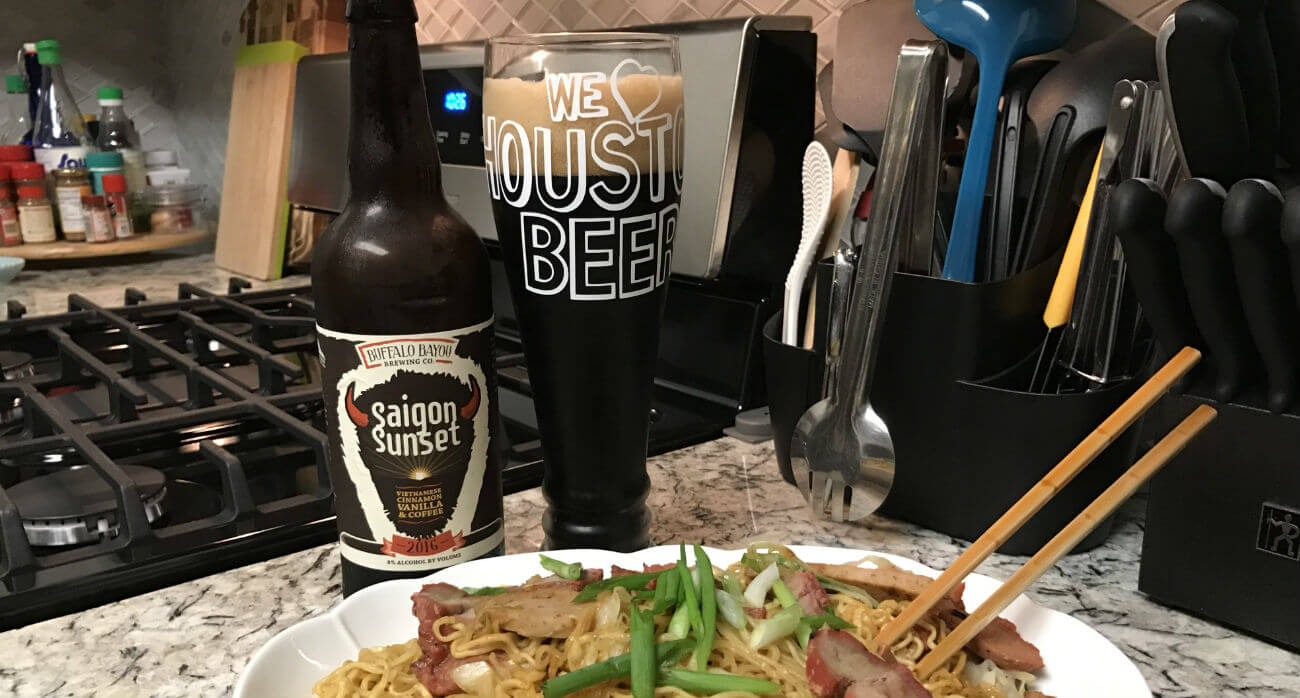 beer-chronicle-houston-craft-beer-review-saigon-sunset-beer-next-to-bottle-in-front-of-noodles