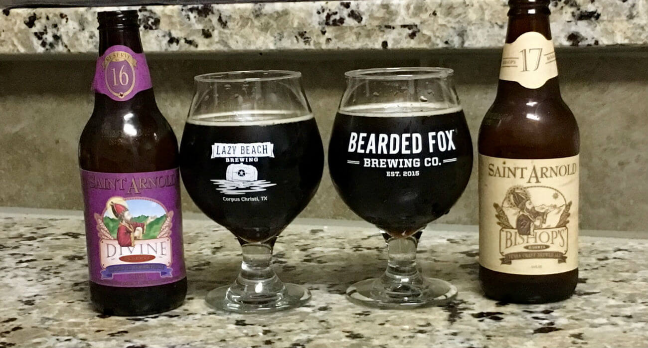 Beer-Chronicle-Houston-Craft-Beer-Review-Saint-Arnold-Bishops-Barrel-17-vs-Divine-Reserve-16-Side-By-Side-Full-Glasses-Next-To-Bottles