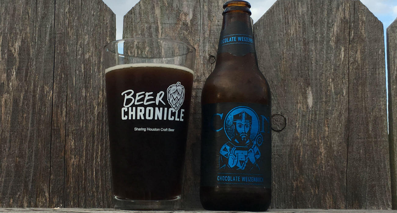 Beer-Chronicle-Houston-Craft-Beer-Review-Saint-Arnold-Icon-Blue-Chocolate-Weizenbock-Full-Glass-Next-To-Bottle