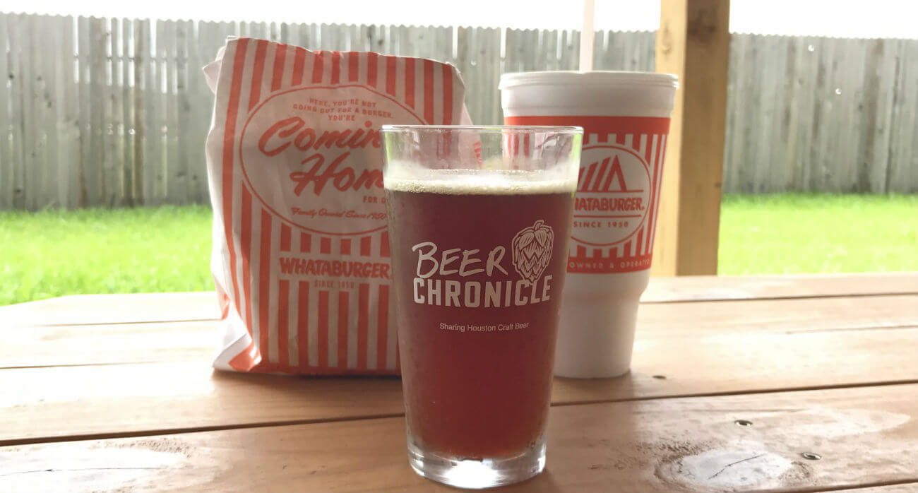 Beer-Chronicle-Houston-Craft-Beer-Review-Saytrs-Swill-Beer-In-Pint-Glass-With-Whataburger